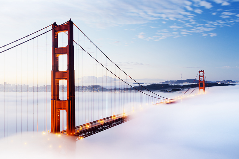 Golden Gate bridge in San Francisco, shrouded in morning mist.